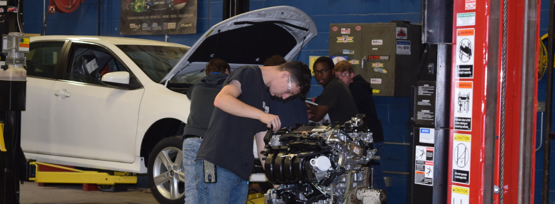 Sophomore Automotive Technology Students work in the shop.